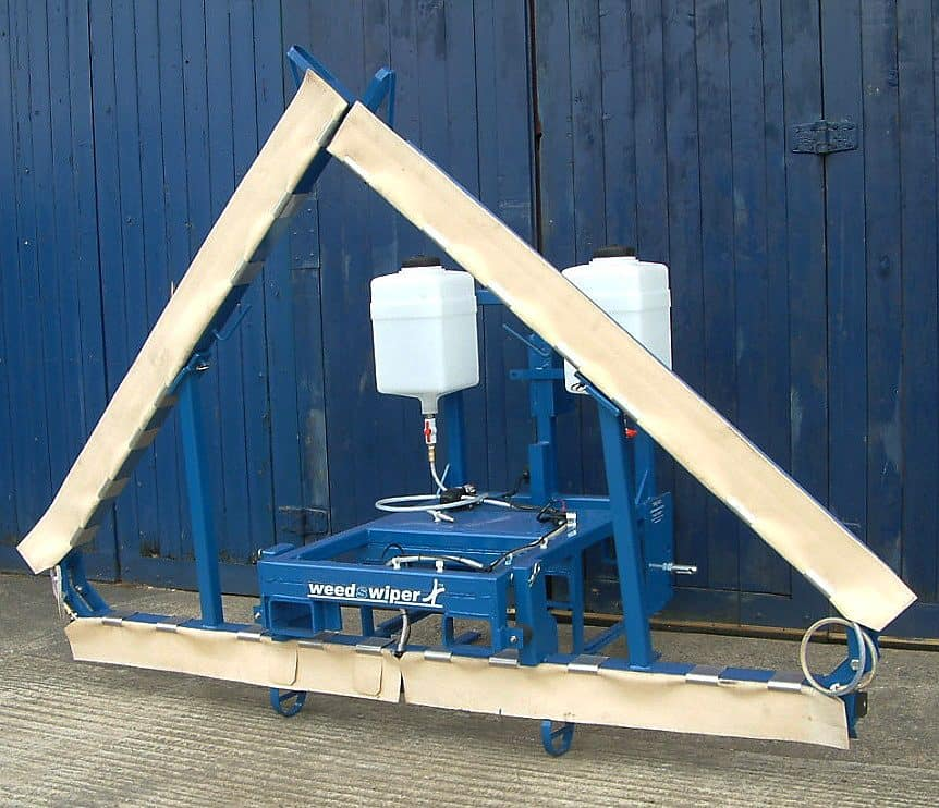 A photo of the Edlington Front Mounted WeedSwiper in transport position.